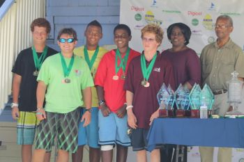 Third place finisher Bahamas received their medals from Premier and Minister of Finance Dr the Honourable D. Orlando Smith and BVITB's Lynette L. Harrigan. Photo:VINO