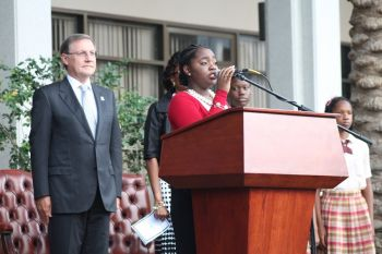 Ms Fifth Form Mya Brown sings the National Anthem at the swearing in ceremony on June 10, 2015. Photo: VINO