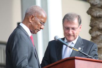 Premier and Minister of Finance Dr The Honourable D. Orlando Smith takes the Oath of Office before His Excellency, Governor John S. Duncan. Photo: VINO