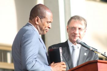 Honourable Mark H. Vanterpool, the 'Action man', being sworn in as Minister for Communications and Works at yesterday's June 10, 2015 ceremony. Photo: VINO