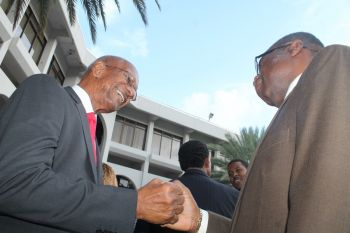 Premier Dr The Honourable D. Orlando Smith and Virgin Islands Party Chairman Hon Julian Fraser RA (R3) show camaraderie at the swearing-in ceremony. Photo: VINO