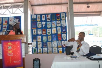 Miss BVI 2014 Jaynene Jno Lewis (standing) and President of the Rotary Club of Tortola Henry O. Creque. Photo: VINO
