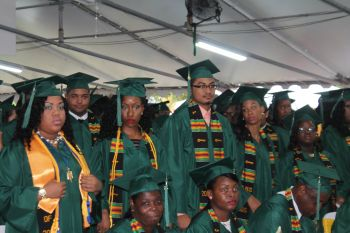 Standing are some of the students who graduated with Associate Degrees. Photo: VINO