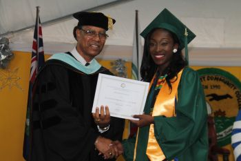Ms Keyonna A. Farrington receives the President's Award from Dr Bryan Penn. Photo: VINO