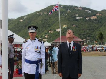 From left: Police Commissioner Michael Matthews and Governor John S. Duncan OBE at the hoisting of the flag at the Queen's Birthday Parade at Wickham's Cay II on June 17, 2017. Photo: VINO
