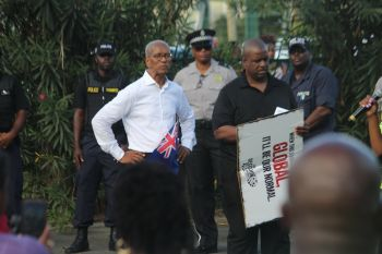 Premier and Minister of Finance Dr The Hon D. Orlando Smith (AL), left, and Opposition Leader Hon Andrew A. Fahie (R1), right, at Decision March 2018. Photo: VINO