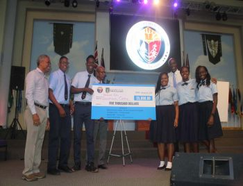 Ninth District Representative Dr The Honourable Hubert R. O'Neal, left, Premier and Minister of Finance Dr The Honourable D. Orlando Smith (AL), centre, and Minister for Education and Culture Honourable Myron V. Walwyn (AL), right, with the second place winners of $5,000, Bregado Flax Educational Centre Secondary Division. Photo: VINO