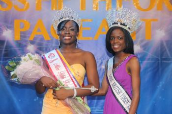 Kadian Johnson (Left), seen here with reigning Miss BVI Sharie B. deCastro, copped the coveted crown in front of a noisy crowd at the Miss Fifth Form Pageant at the Multi-Purpose Sports Complex last night, January 19, 2013. Photo: Reuben Stoby/VINO