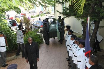 The body of Richard D. Holder is taken to the Road Town Methodist Church for viewing and service. Photo: VINO