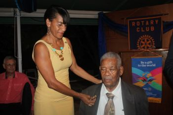 Former legislator Mr Ralph T. O'Neal OBE being presented with the Paul Harris Fellow award by Rotary Assistant Governor, Delma Maduro. Photo: VINO
