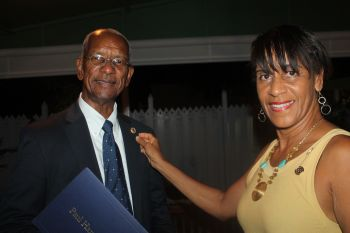 Premier Dr The Hon D. Orlando Smith being presented with the Paul Harris Fellow award by Ms Delma Maduro. Photo: VINO