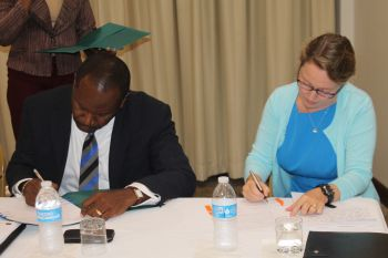 Mr Denniston S. Fraser, Managing Director, signed on the behalf of the BVIAA, Ms Sarah E. Hatcher for the IABVI. Photo: VINO