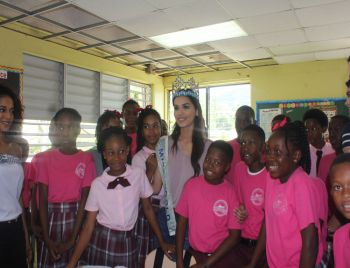 Students of Althea Scatliffe Primary School pose with Miss World 2017 Manushi Chhillar and delegation today, February 25, 2018. Photo: VINO
