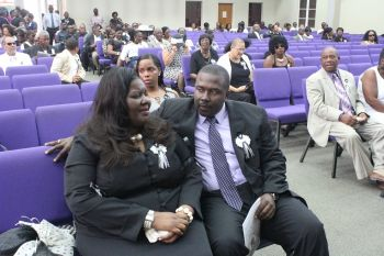 Mrs Oleanvine Pickering-Maynard being consoled by Eighth District representative Marlon A. Penn. Photo: VINO