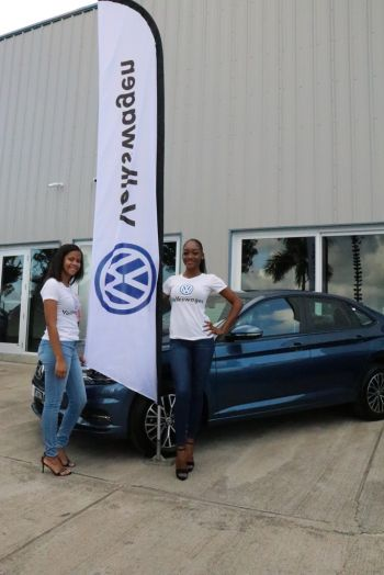 Volkswagen girls Akia Pereira, left, and former Miss World BVI Sasha O. Wintz at the unveiling of Volkswagen at Tortola Auto Group (TAG) on March 25, 2019. Photo: VINO