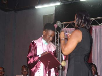 Amari Blyden, Salutatorian of the Althea Scatliffe Primary School, receiving a medallion for his top achievements. Photo: VINO/File