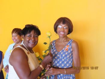 Founder and Chief Executive Officer of LGS and Associates – Mrs Lorna G. Smith, OBE, MA, TEP being pinned by Zonta President Nona Vanterpool-Bonelli. Photo: Provided