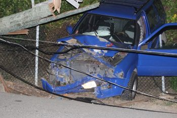 The community of Paraquita Bay and surrounding areas were plunged into darkness this evening, August 22, 2013 following a horrible non-fatal smashup involving a blue Nissan jeep (PA 141) that slammed into a now downed utility pole. Photo: VINO