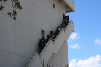 Persons streaming down the fire escape of the Central Administration Complex today. Photo: VINO