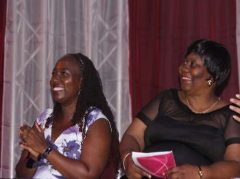 Ms Simone E. Martin, Keynote Speaker (left) and Ms. Marieta C. Flax-Headley, Principal of Althea Scatliffe Primary School (right), are filled with joy as they watch the Class of 2017 receive their diplomas. Photo:VINO/File