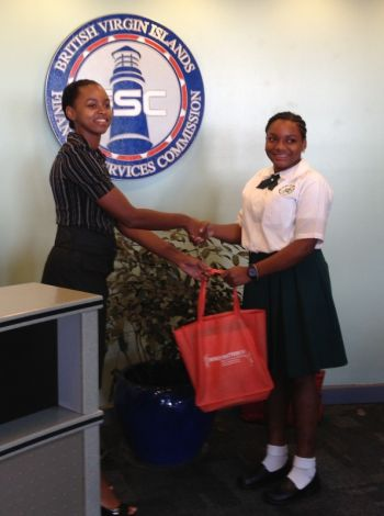 Jada Samuel of St. Georges Secondary receives her prize from Ms Natoya Frett of the BVI Financial Services Commission. Photo: Provided