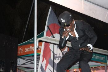 Reggae artist Ghost belting out one of his tunes on stage. Photo: VINO