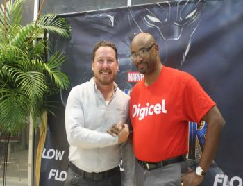 Country Manager for Flow, Colin MacDonald (left) and Kevin R. Gordon, CEO of Digicel (right) came out to support the reopening of UP's Cineplex and the premiere of Black Panther. Photo: VINO