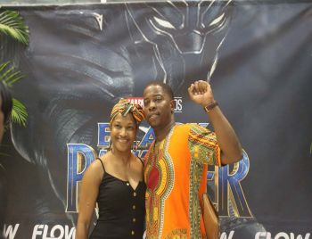 Honourable Melvin M. Turnbull, Second District Representative (right), and his wife at the reopening of UP's Cineplex and premiere of Black Panther. Photo: VINO