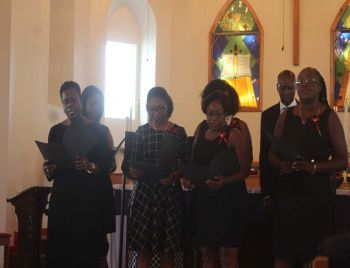 Members of the H. Lavity Stoutt Community College (HLSCC) paying a tribute to the family through song. Photo: VINO