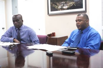 Executive Director of BVI Finance Kedrick E. Malone and acting Permanent Secretary in the Office of the Premier today April 1, 2015 at the informal session at BVI Finance. Photo: VINO