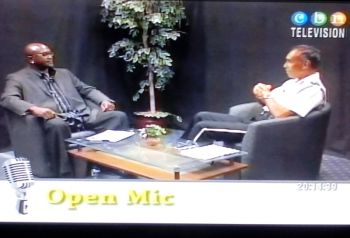 Outgoing Commissioner of Police David Morris (right) was a guest of Open Mic hosted by Mr Julio S. Henry and aired on CBN Channel 51 on August 1, 2015. Photo: VINO
