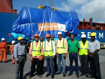 Front row, third from left: Minister for Communiciations and Works Hon Mark H. Vanterpool (R4), General Manager of BVIEC Mr Leroy A. E. Abraham and Deputy General Manager Mr Henry O. Creque, were present at the Port Purcell dock this morning, August 19, 2016 to witness the offloading of the three new generators for the BVIEC's Phase V Project. Photo: VINO