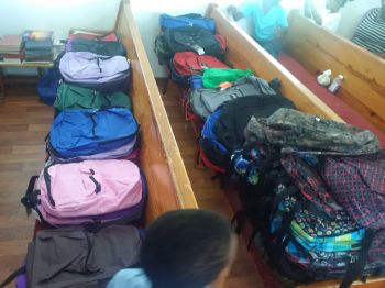 Some of the backpacks that were presented to children of Purcell on August 20, 2016. Photo: VINO