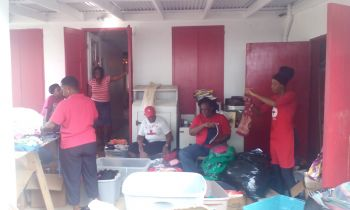 BVI Red Cross volunteers preparing packages to be distributed to persons and families that are in need following the devastating flash flood on Monday August 7, 2017. Photo: VINO
