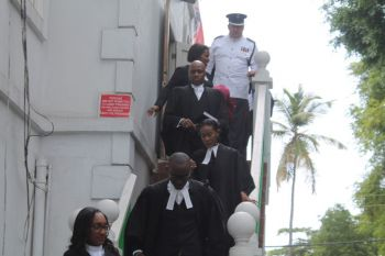 Lawyers practising in the Eastern Supreme Supreme Court leaving the special sitting for the opening of the Law Year 2015-16 at the High Court of the Virgin Islands on September 18, 2015. Photo: VINO