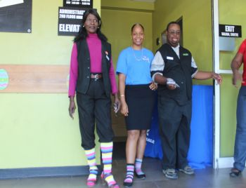 Staff of RiteWay Food Markets and BVI Health Services Authority (BVIHSA) wearing coloured socks in support of World Down Syndrome Awareness Day (WDSD). Photo: VINO