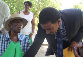 Acting Premier Dr The Hon Kedrick D. Pickering shares a moment with Mr William I. Rhymer. Photo: VINO