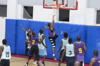 Glenal Layne had an impressive 28 points and 22 rebounds for Talk Done but it was Ruff House who took the win in Game 2 of the Division Finals in the Hon. Julian Fraser/Save the Seed National Intermediate Basketball League on October 26, 2013. Photo: VINO