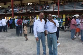 Premier Dr The Honourable D. Orlando Smith (left) and Virgin Islands Party Chairman Hon Julian Fraser RA (R3) spent much time together at the post Easter races at Ellis Thomas Downs on April 12, 2015. Photo: VINO