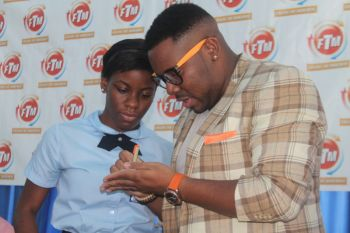 The young lady who won Mr Kareem-Nelson Hull's birthday giveaway prize smart phone. Photo: VINO