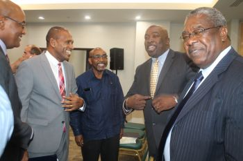 Minister for Communications and Works Honourable Mark H. Vanterpool and Minister for Health and Social Development Ronnie W. Skelton (left) in a light moment with CTU members as they discussed matters of telecommunications. Photo: VINO