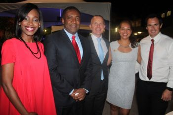 Digicel's senior staff members were present at the regional conference on Information and Communication Technologies (ICT) Week and had engaged Jamaica's Minister of Science, Technology, Energy and Mining Honourable Phillip Paulwell (2nd left). Left is Digicel's PR and Sponsorship Executive Katasha Melville while right is Digicel (BVI) CEO Conor Looney. Photo: VINO