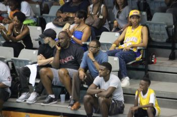 Third District Representative and Virgin Islands Party Chairman Hon Julian Fraser RA, seen here seated next to Keith '88' Malone, pays keen attention to one of the games. Photo: VINO