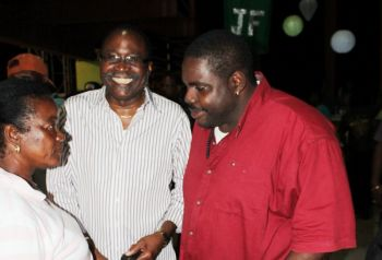 Hon. Julian Fraser (centre) shares a moment with his supporters. Photo: VINO