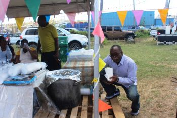 Honourable Julian Fraser RA, Third District Representative, enjoying food from one of the local booths at the VG Easter Festival Explosion Food Fair. Photo: VINO