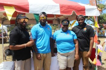 Kareem-Nelson Hull (left), owner of Sweet Tease along with members of his staff at the VG Easter Festival Explosion Food Fair. Photo: VINO