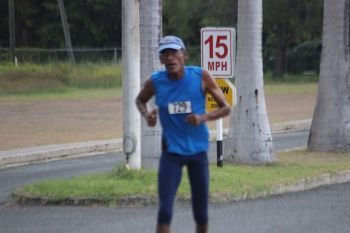 Stephen Baird about to complete his two-mile run. Photo: VINO