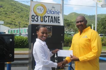 Delta Petroleum's Regional General Manager Mr Bevis A. Sylvester announced the first of what will now be an annual platinum support for the Miss World BVI. Yesterday, August 30, 2013 he presented Ms Malone with a cheque to assist with her travel expenses to Indonesia. Photo: VINO