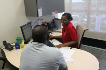 A customer signing up his loan papers for financing of a vehicle on the spot. Photo: VINO