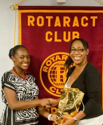 Feliza expresses thanks to a guest speaker during a Rotaract meeting. Photo: supplied